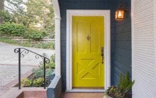 Painting house, exterior with yellow painted door