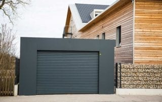 Gray garage door used as a gate