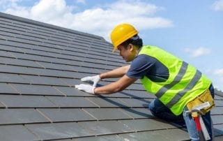 male worker repairing roof