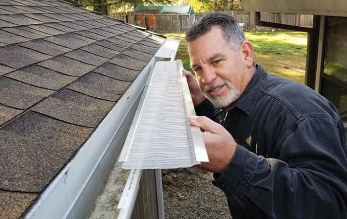Man installing a leftblaster pro gutter cover
