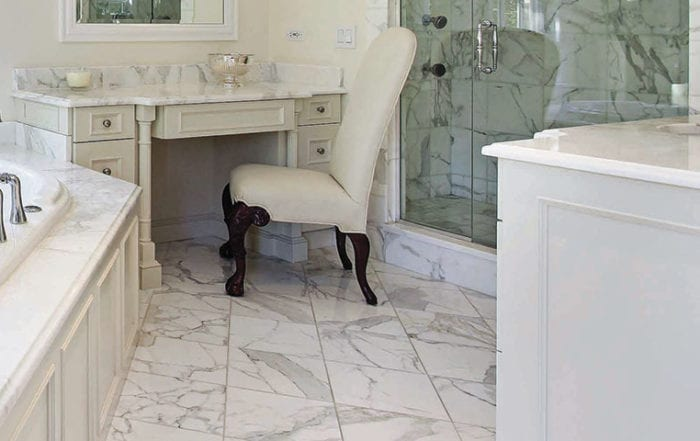 Bathroom with calacatta gold white marble tile