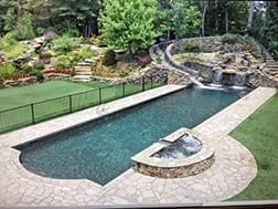 Backyard with pool and waterslide