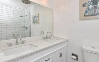 White bathroom remodel with double vanity