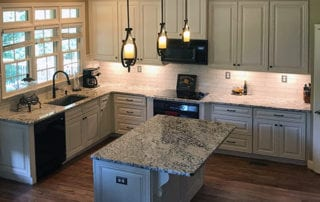 New kitchen remodel with island and pendant lighting